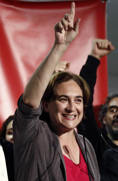 Leader of 'Barcelona en Comu' (Barcelona in Common) party and candidate for mayor of Barcelona Ada Colau celebrates during a press conference following the results in Spain's municipal and regional elections in Barcelona on May 24, 2015.  Partial results showed that the 'Indignado' candidate leads vote in Barcelona.  AFP PHOTO / QUIQUE GARCIA