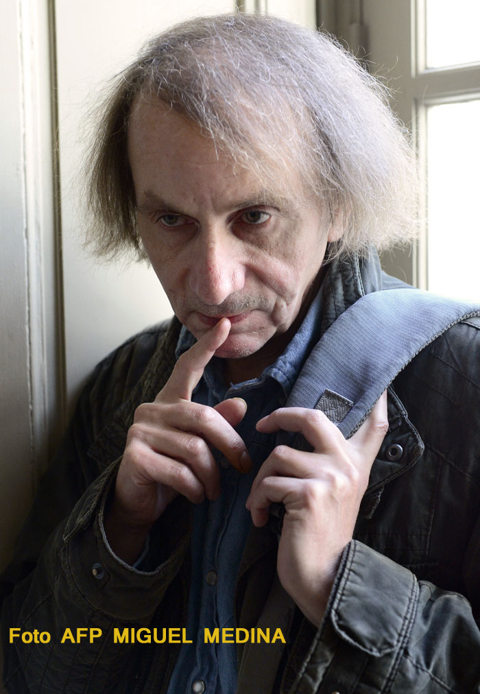 """French writer Michel Houellebecq poses on November 5, 2014 during his photo exhibition """"Before Landing"""" at the Pavillon Carre de Baudouin in Paris. AFP PHOTO/MIGUEL MEDINA"""