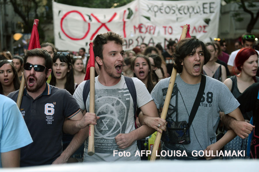 Youth chants  slogans on July 2, 2015 in Athens , during a demonstration supporting the no vote for the upcoming referendum.  Greece's government and international creditors raised the stakes on July 2 over a weekend referendum seen as decisive for the nearly insolvent EU country's political and financial future. While Prime Minister Alexis Tsipras has urged Greeks to vote 'No' to the austerity measures demanded by international creditors, opposition parties including the centre-right New Democracy are campaigning for a 'Yes' vote in the referendum on July 5.  AFP PHOTO / Louisa Gouliamaki