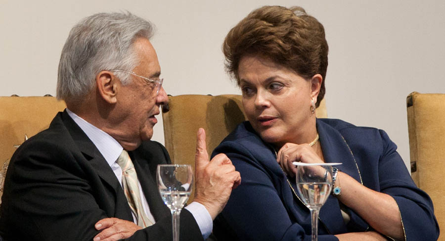 Brazil's Former President Fernando Henrique Cardoso (L) and Brazil's President Dilma Rousseff talk during the inauguration of the governmental plan 'Brazil Without Poverty' at the Bandeirantes Palace in Sao Paulo, Brazil, on August 18, 2011. AFP PHOTO/YASUYOSHI CHIBA