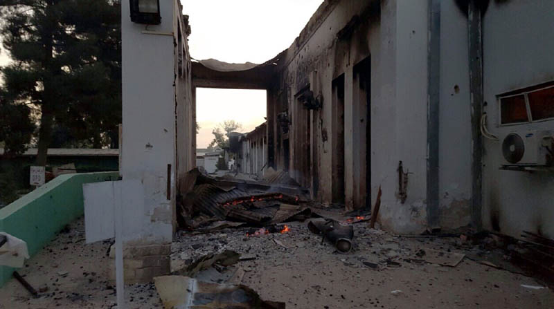 "In this photograph released by Medecins Sans Frontieres (MSF) on October 3, 2015, fires burn in part of the MSF hospital in the Afghan city of Kunduz after it was hit by an air strike. An air strike on a hospital in the Afghan city of Kunduz on October 3 left three Doctors Without Borders staff dead and dozens more unaccounted for, the medical charity said, with NATO conceding US forces may have been behind the bombing. The MSF facility is seen as a key medical lifeline in the region and has been running ""beyond capacity"" during recent fighting that saw the Taliban seize control of the provincial capital for several days. AFP PHOTO / MSF ----EDITORS NOTE---- RESTRICTED TO EDITORIAL USE - MANDATORY CREDIT ""AFP PHOTO/MSF"" - NO MARKETING NO ADVERTISING CAMPAIGNS - DISTRIBUTED AS A SERVICE TO CLIENTS -----"