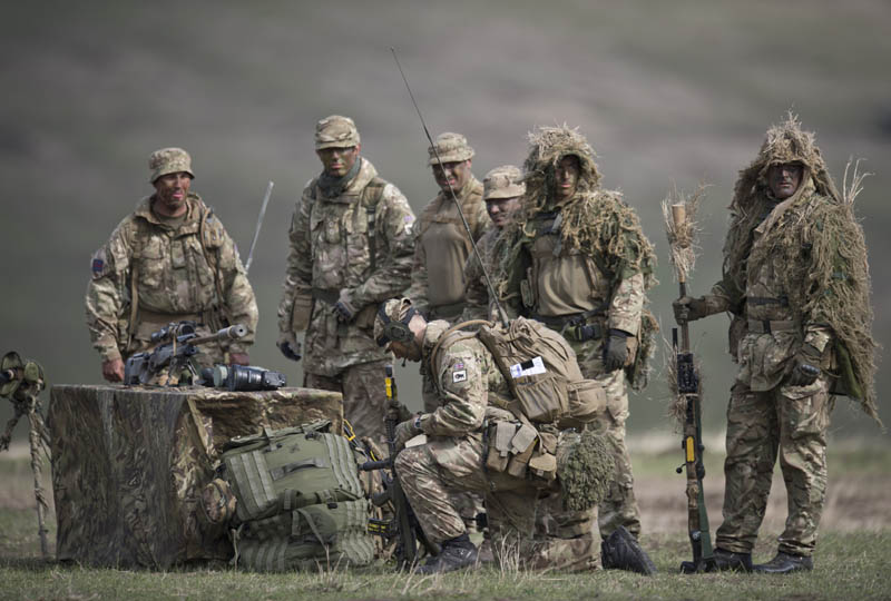 "British army personnel take part in the NATO ""Wind Spring 15"" military exercise at Smardan military shooting range on April 21, 2015. Over 2,200 servicemen of the armies of the United Kingdom of Great Britain and Northern Ireland, the Republic of Moldova, Romania and the United States of America are involved in the ""Wind Spring 15"" multinational exercise, that is taking place until April 30  in the Smardan range of Galati County. AFP PHOTO DANIEL MIHAILESCU"