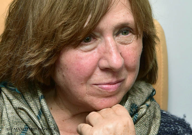 "Belarus' writer and journalist Svetlana Alexievich attends a press conference in Minsk, on October 8, 2015, following the announcement of her Nobel Literature Prize earlier in the day. Nobel prize winning Belarusian author Svetlana Alexievich on October 8 said she loved the Russia of ""ballet, literature and ballet"" but not the country it has become under President Vladimir Putin. AFP PHOTO / MAXIM MALINOVSKY"