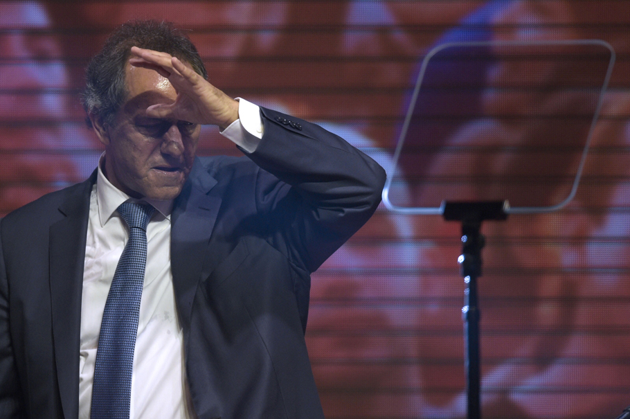 Argentine presidential candidate Daniel Scioli gestures at the party's headquarters in Buenos Aires on October 25, 2015. Buenos Aires Governor Daniel Scioli led Argentina's presidential election race as counting got under way Sunday, but it was unclear whether he would avoid a runoff against his conservative rival Mauricio Macri.