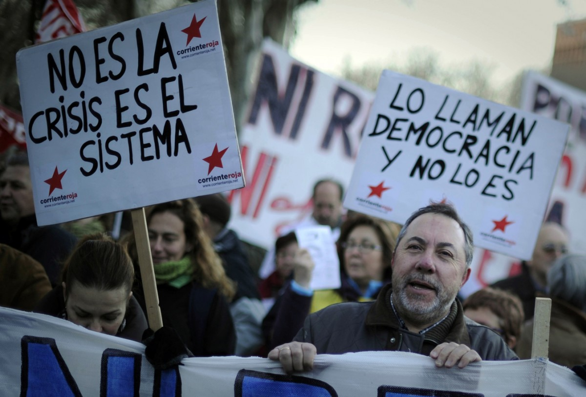 Thousands of people demonstrate in Madrid, on February 7, 2012 against government policies and social cuts imposed during the crisis. AFP PHOTO/Pedro ARMESTRE