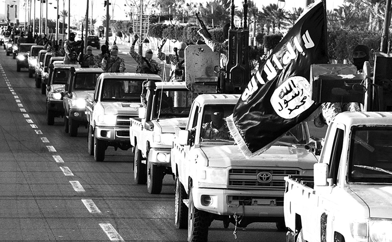 "An image made available by propaganda Islamist media outlet Welayat Tarablos on February 18, 2015, allegedly shows members of the Islamic State (IS) militant group parading in a street in Libya's coastal city of Sirte, which lies 500 kilometres (310 miles) east of the capital, Tripoli. Egyptian F-16s bombed militant bases in the eastern Libyan city of Derna in mid-February after the Islamic State group in Libya released a gruesome video showing the beheadings of a group of Egyptian Coptic Christians who had gone to the North African country seeking work. AFP PHOTO / HO / WELAYAT TARABLOS === RESTRICTED TO EDITORIAL USE - MANDATORY CREDIT ""AFP PHOTO / HO / WELAYAT TARABLOS"" - NO MARKETING NO ADVERTISING CAMPAIGNS - DISTRIBUTED AS A SERVICE TO CLIENTS FROM ALTERNATIVE SOURCES, AFP IS NOT RESPONSIBLE FOR ANY DIGITAL ALTERATIONS TO THE PICTURE'S EDITORIAL CONTENT, DATE AND LOCATION WHICH CANNOT BE INDEPENDENTLY VERIFIED ==="
