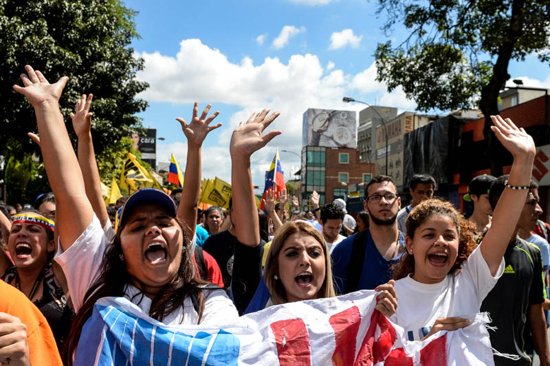 Venezuelan anti-government students participate in the celebrations for the University Students' Day, in Caracas, on November 21, 2015. AFP PHOTO/FEDERICO PARRA / AFP / FEDERICO PARRA