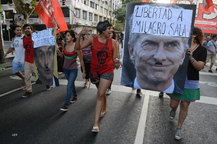 Members of leftist organizations march in Buenos Aires on January, 27, 2016 demanding the release of Milagro Sala, the president of Tupac Amaru neighborhood association. Sala was detained on January 16 during a social protest. AFP PHOTO/EITAN ABRAMOVICH / AFP / EITAN ABRAMOVICH