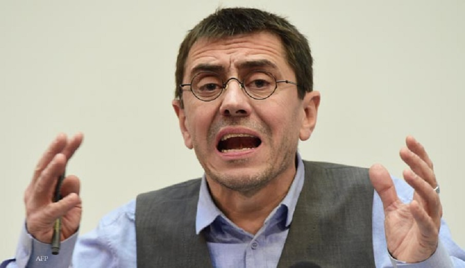 Spanish Secretary of Constituent Process and Programme of Podemos, Juan Carlos Monedero, speaks during a press conference in Madrid, on February 20, 2015. Political science professor and founder of Podemos, Juan Carlos Monedero, finds himself embroiled in allegations of tax irregularities that forced him to publish his bank statements in an effort to silence critics.  AFP PHOTO / JAVIER SORIANO / AFP / JAVIER SORIANO