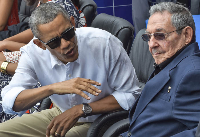 "US President Barack Obama speaks next to Cuban President Raul Castro (R) during a Major League baseball exhibition game between the Tampa Bay Rays and the Cuban national team at the Latinoamericano stadium in Havana on March 22, 2016. Obama praised the bravery of Cuban dissidents Tuesday in a meeting at the US embassy in Havana, although opponents back home dismissed the event as a ""token"" gesture. AFP PHOTO / Nicholas KAMM / AFP / NICHOLAS KAMM"