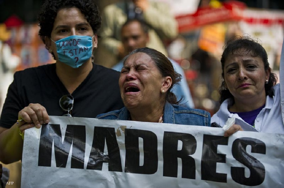 A mother cries during a protest in Mexico City on May 10, 2013. A group of mothers and relatives of children missing due to the drug war in the country, demand to the Government the investigation of the crimes. AFP PHOTO/RONALDO SCHEMIDT / AFP / Ronaldo Schemidt