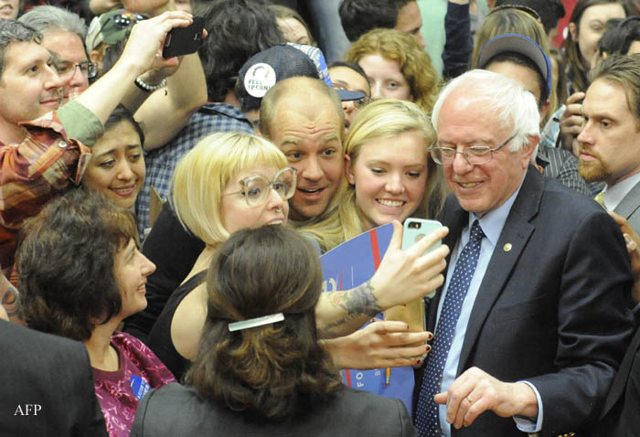 US Democratic presidential candidate Bernie Sanders greets supporters after addressing a rally at Colorado State University's Molby Areana in Ft. Collins, Colorado, February 28, 2016.  / AFP / Jason Connolly