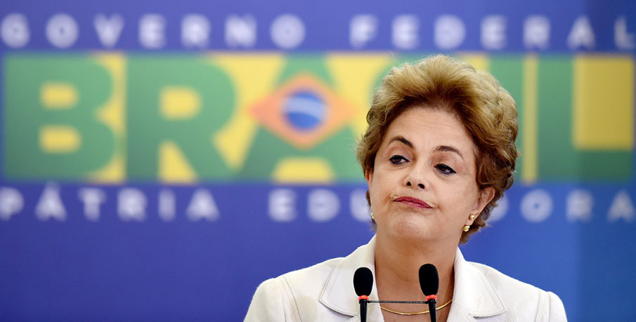 Brazilian President Dilma Rousseff gestures during the Education in Defense of Democracy event, at the Planalto Palace in Brasilia, on April 12, 2016.  Rousseff entered the final straight Tuesday of a desperate battle to save her presidency ahead of an impeachment vote in Congress this weekend. / AFP PHOTO / EVARISTO SA