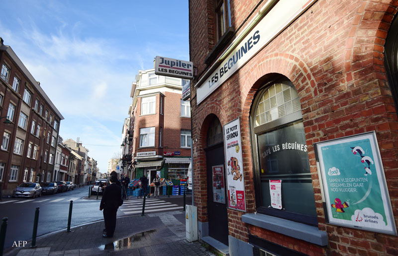 """A view of the bar """"Les Beguines"""", owned by Brahim Abdeslam, one of the suicide bombers implicated in the Paris attacks, on November 17, 2015 in Brussels' Molenbeek district. Abdeslam, 31, detonated his suicide vest outside the Comptoir Voltaire on Boulevard Voltaire on November 13, 2015, as part of a spate of coordinated attacks in Paris that left at least 129 dead and over 350 injured. AFP PHOTO / EMMANUEL DUNAND / AFP / EMMANUEL DUNAND"""