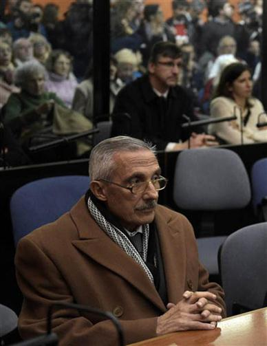 "Former Argentine intelligence agent Miguel Angel Furci (L) gestures as he waits to hear the sentence to be handed down by the court in the trial on Operation Condor, in which six South American dictatorships collaborated to torture and kill their opponents, in Buenos Aires on May 27, 2016. South American ex-military leaders faced judgment Friday for their alleged role in the torture and assassination of leftist dissidents during a US-backed crackdown by the region's dictatorships during the 1970s and 1980s. Argentine judges were considering their verdict in the trial of 18 former army officers accused of taking part in ""Operation Condor."" In that scheme, the military regimes of Argentina, Bolivia, Brazil, Chile, Paraguay and Uruguay helped each other track down and kill leftist dissidents.  On Friday, the court convened to deliver its verdict after a three-year trial -- the first to try the crimes committed under the Condor plan / AFP PHOTO / JUAN MABROMATA"