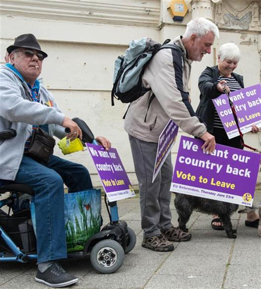 UK Independence Party supporters await the arrival of leader Nigel Farage as he goes on the campaign trail for Brexit in Ramsgate on June 13, 2016.  Britain's opposition Labour Party today scrambled to make the case for Europe to its members as world stock markets slipped amid concern over a British exit from the EU in a knife-edge referendum next week. / AFP PHOTO / CHRIS J RATCLIFFE