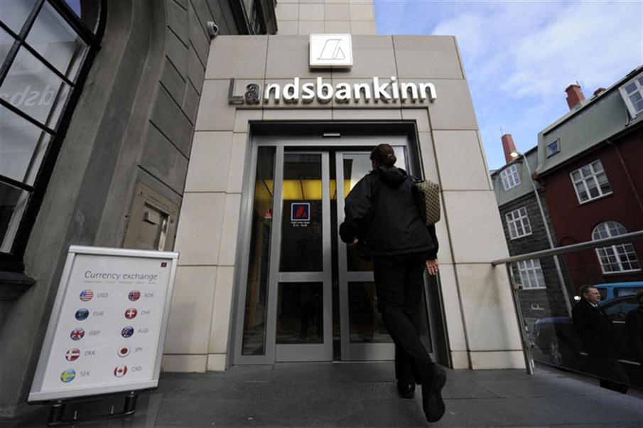 "FILES- A file picture shows a woman entering a branch of Iceland's second largest bank, Landsbanki (Landsbankinn) on October 8, 2008 in Rejkjavik. The Icelandic central bank lied to its Dutch counterpart about the soundness of Landsbanki, mother company of failed bank Icesave, an ex-managing board member of the Dutch institution alleged on February 1, 2010.  ""The Icelandic colleagues, I can't say it any other way, lied to us,"" Arnold Schilder, responsible for bank supervision at the time of the Icesave collapse, told a parliamentary inquest into the global credit crisis.      AFP PHOTO / OLIVIER MORIN / AFP PHOTO / OLIVIER MORIN"