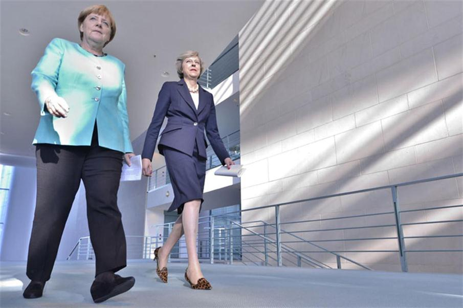 German Chancellor Angela Merkel (L) and British Prime Minister Theresa May arrive to address a press conference after talks at the chancellery in Berlin on July 20, 2016.  / AFP PHOTO / John MACDOUGALL