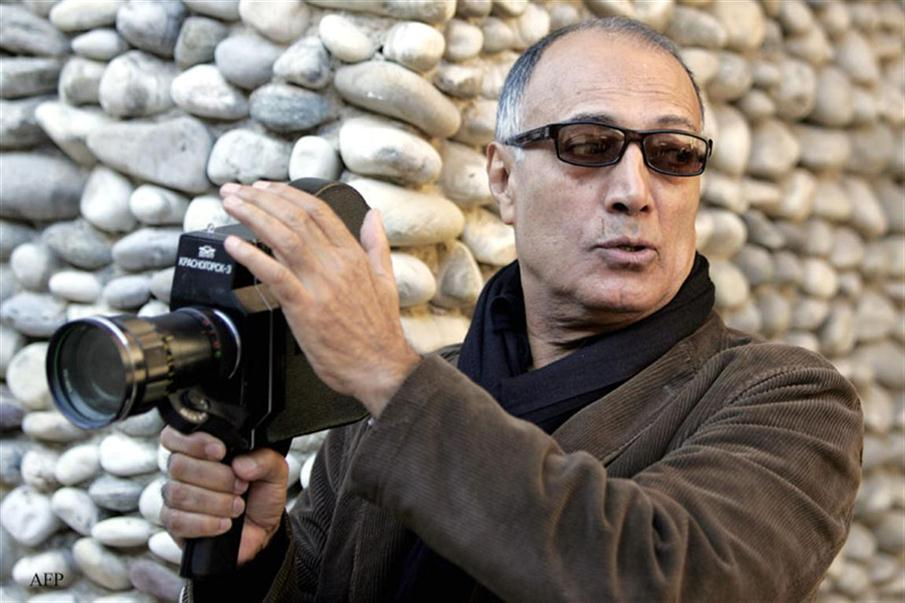 (FILES) This file photo taken on December 4, 2007 shows internationally acclaimed Iranian film maker Abbas Kiarostami giving instructions during a course with students of the Villa Arson art school in Nice. Famed Iranian director Kiarostami died aged 76 in Paris on July 4, 2016, Iranian media reported. / AFP PHOTO / ERIC ESTRADE
