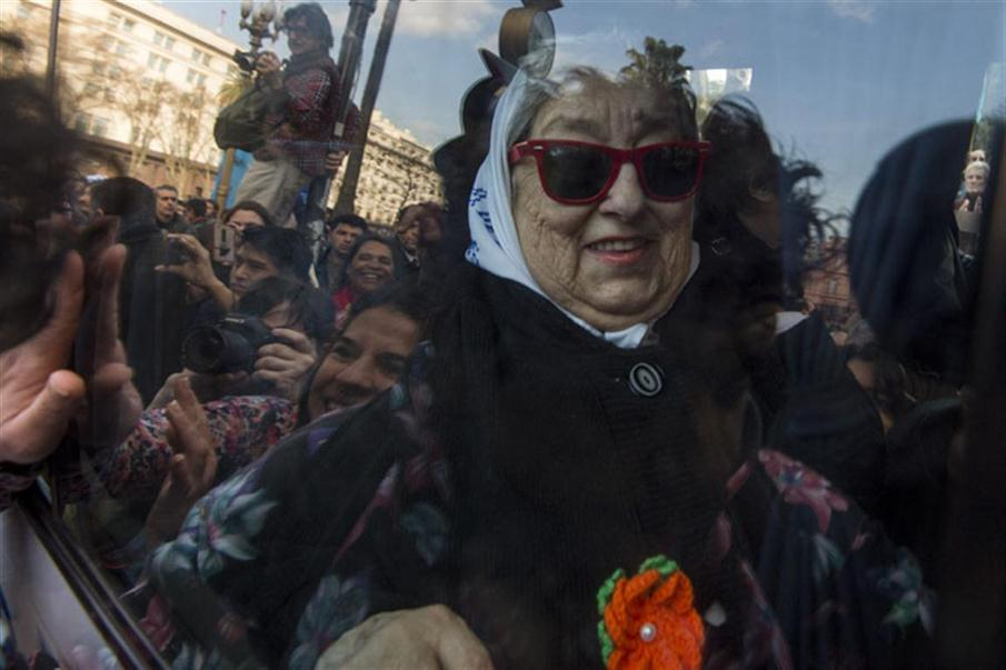 Hebe de Bonafini, leader of the Mothers of Plaza de Mayo human rights organization,   leaves Plaza de Mayo square in Buenos Aires, Argentina, on August 04, 2016. An Argentine judge issued an arrest warrant Thursday for the head of the acclaimed human rights group Mothers of the Plaza de Mayo, which is caught up in a politically messy corruption case. / AFP PHOTO / EITAN ABRAMOVICH