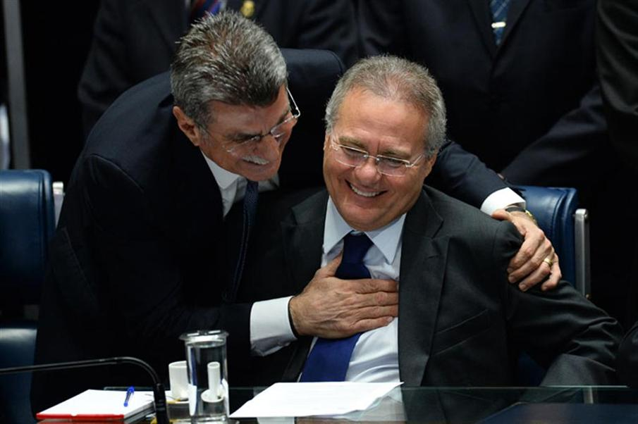 Brazil's Senate president Renan Calheiros (R) and senator Romero Juca are pictured during the impeachment vote against suspendend President Dilma Rousseff, at the Senate in Brasilia, on August 31, 2016. Brazil's Senate met Wednesday to vote on stripping Dilma Rousseff of the presidency in a traumatic impeachment trial set to end 13 years of leftist rule over Latin America's biggest country. Rousseff is accused of taking illegal state loans to patch budget holes in 2014, masking the country's problems as it slid into its deepest recession in decades. / AFP PHOTO / ANDRESSA ANHOLETE