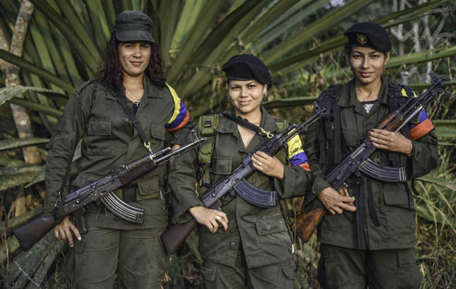 (L to R) Luisa, Manuela and Rosmira, members of the Revolutionary Armed Forces of Colombia (FARC), pose for a picture at a camp in the Colombian mountains on February 18, 2016. Many of these women are willing to be reunited with the children they gave birth and then left under protection of relatives or farmers, whenever the peace agreement will put an end to the country's internal conflict.    AFP PHOTO / LUIS ACOSTA / AFP PHOTO / LUIS ACOSTA