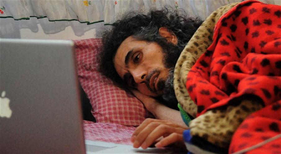 (FILES) This file photo taken on September 9, 2016 shows 45-year-old Jihad Diyab, a former Guantanamo inmate from Syria who was resettled in Uruguay, lying on a matress on the floor of his house as he holds a hunger strike, in Montevideo. Doctors announced that Diyab is in a mild coma as a result of a hunger strike over resettlement, in his home in Montevideo.  / AFP PHOTO / Dante FERNANDEZ